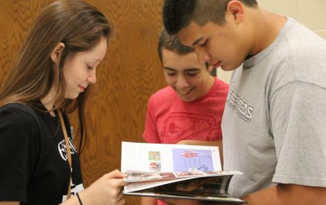 Destiny Martin, Jordan Rauh and Devin Blood look through their yearbooks to find themselves.