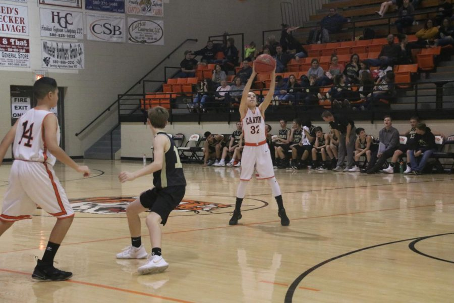 Burton and Foster High Scorers in Tiger Loss
