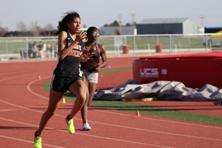 Senior LaShayla Green fights a strong headwind at the Cherokee track meet in Cherokee, Oklahoma on March 15, 2018, while running the 200 meter dash. Green placed first in this event.