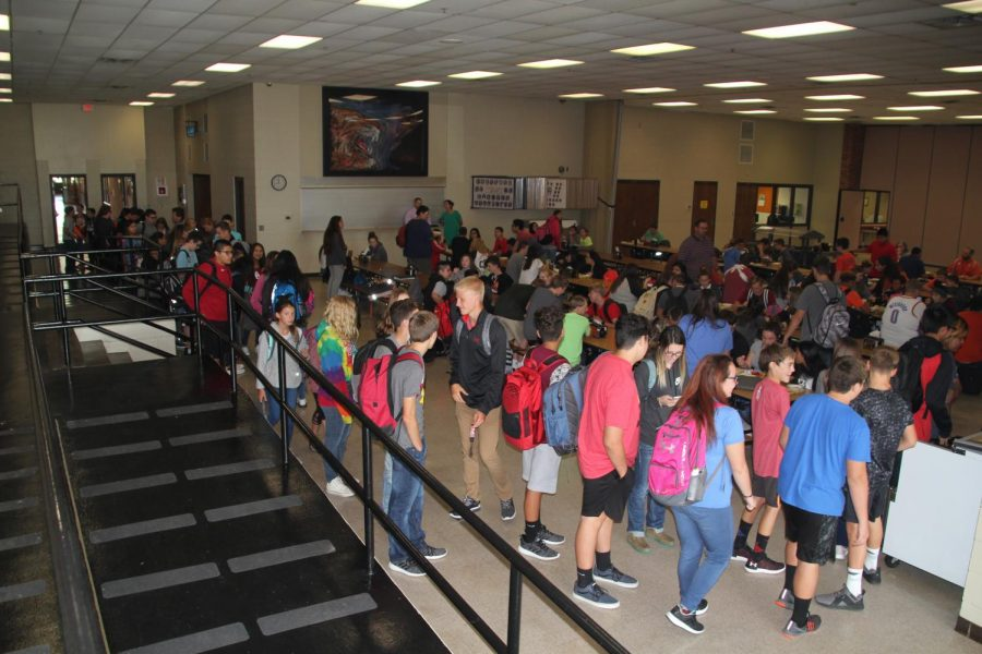 Students wait in the line that reaches to the cafeteria doors.