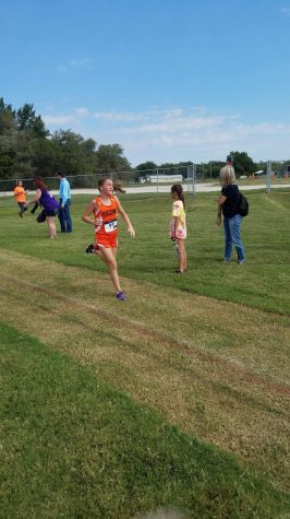 Lady Cross Country teams Medals At Cherokee