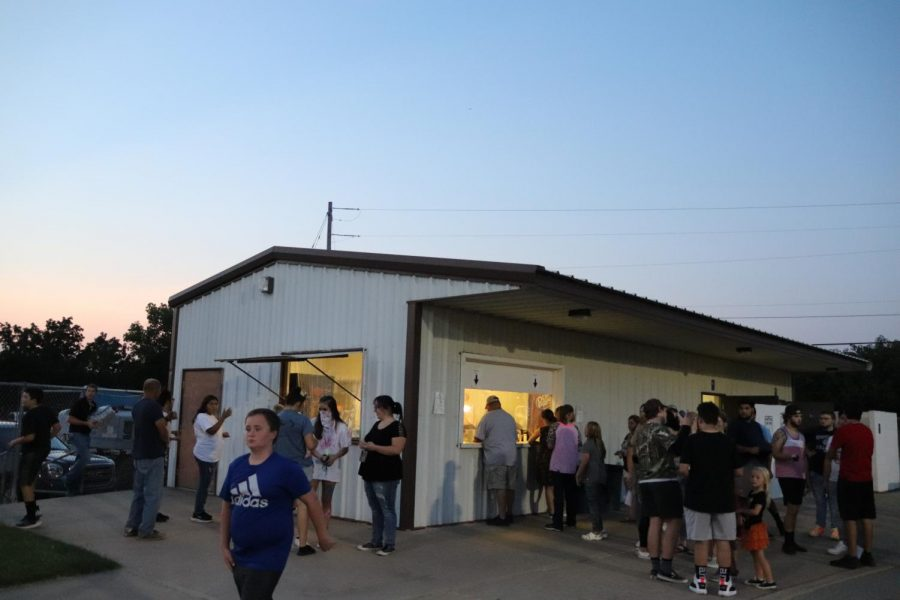 Customers wait in line at concession stand at the Tiger's first football game.