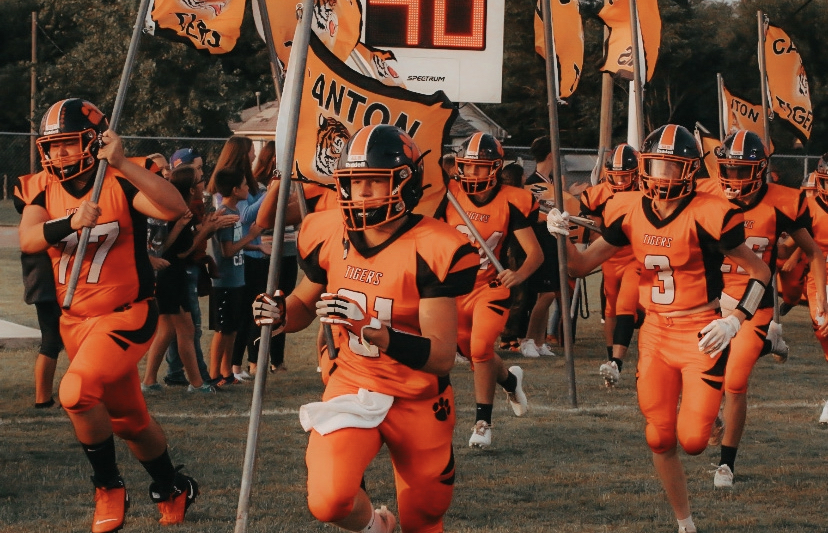 The football team rushes onto the field prior to their big win.