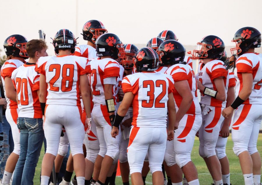 The Canton Tigers huddle before the game for their pre-game hype.