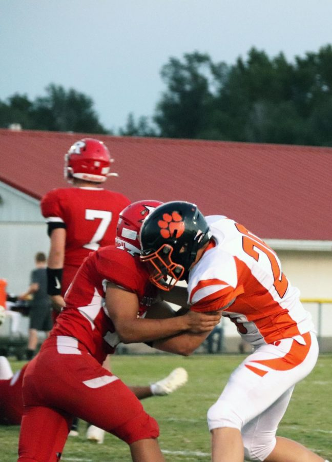 Sophomore Connor Cox blocks Ringwood defender.