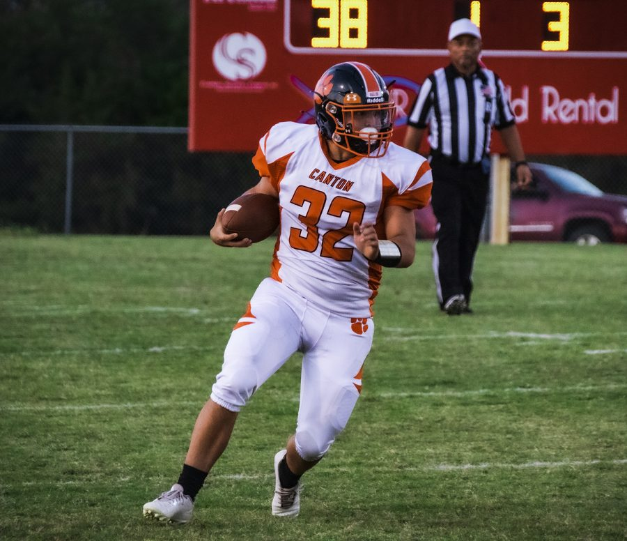 Junior Johnny Burton runs with the football in the 2nd quarter.
