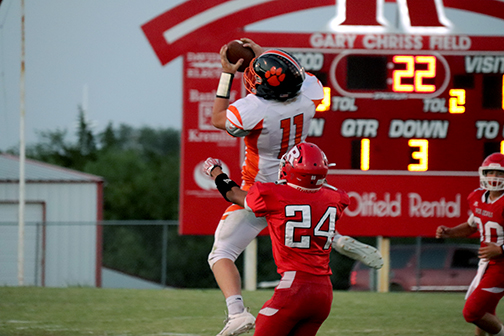 Senior Seth Bromlow jumps up to catch a pass in the 1st quarter.