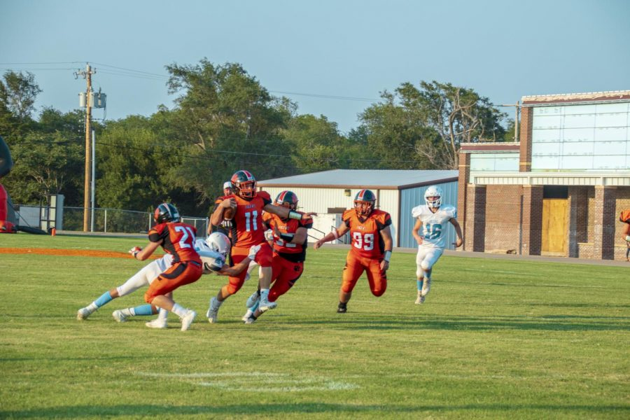 Seth Bromlow pushes through Okeene defense for a first down.