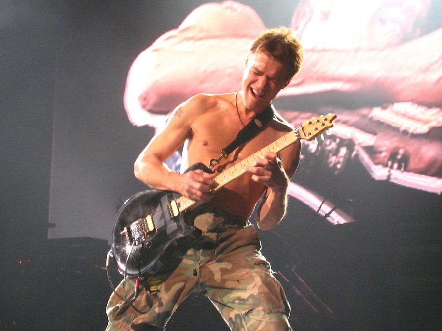Eddie Van Halen shredding his guitar while playing Eruption.  Anirudh Koul from Montreal, Canada / CC BY (https://creativecommons.org/licenses/by/2.0)