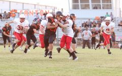 J.J. Ibarra stiff arms Ringwood Red Devil to score a touchdown.