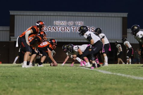 Canton Tigers offensive line lines up for the next play.