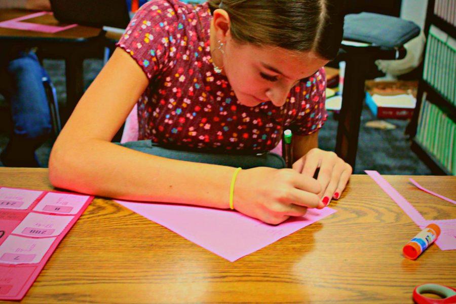 Seventh grader Bella Swartwood does math homework.